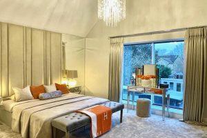 Floor to ceiling headboard helps to create that hotel look